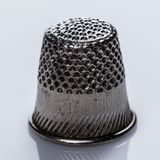 Tailoring. Thimble, also known as finger guard Stock Photos