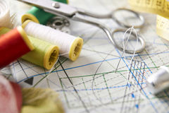 Tailoring tools on clothing pattern elevated view close up Stock Image