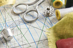 Tailoring tools on clothing pattern elevated view Stock Images