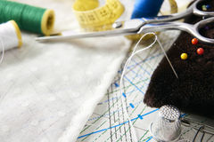 Tailoring tools on clothing pattern and fabric elevated view Royalty Free Stock Image