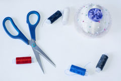 Tailoring tools are scissors needle and threads Royalty Free Stock Photo