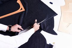 Tailors Hands Cutting Fabric Stock Images