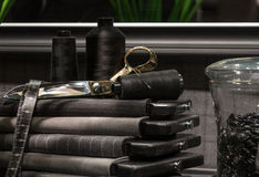 Tailors Scene. Collection of Tailors Scissors, Suit Cloth, Tape Measure and Books Together Royalty Free Stock Image