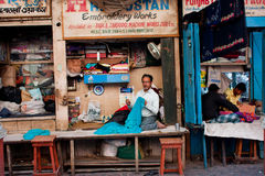 Tailors works in small workshops in the street in  Royalty Free Stock Image