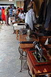 Tailors and Sewing Machines on an African Street. A group of tailors working with their sewing machines on a street in Arusha, Tanzania royalty free stock photo