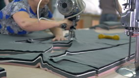 Tailors slowly cut out pattern shapes on fabric. stock footage