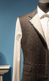 Tailors Suit on Dummy. Work in Progress Suit on Mannequin with Exposed Stitching Royalty Free Stock Photography