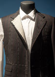 Tailors Suit on Dummy. Work in Progress Suit on Mannequin with Exposed Stitching Royalty Free Stock Image