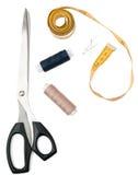 Tailors tools - scissors, thread and tape measure Stock Photo