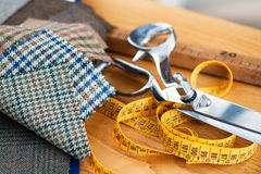 Tailors tools on a wooden workbench Royalty Free Stock Photo