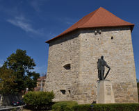 Tailors' Tower and Baba Novac Monument, Cluj, Romania. A depiction of the best conserved piece of Cluj-Napoca's 17th century ramparts. The medieval edifice of stock image