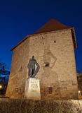 Tailors' Tower and Baba Novac Monument, Cluj, Romania. A depiction of the best conserved piece of Cluj-Napoca's 17th century ramparts, as seen at the blue hour royalty free stock images