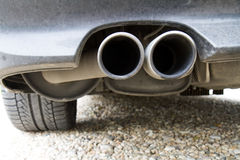 Coming out the exhaust. Tailpipes of a car showing where the exhaust comes from Royalty Free Stock Photos