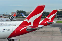 Tails of Jetstar International, Qantas and ANA Cargo aircraft at Changi Airport Stock Images