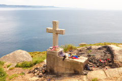 Tails located in the lighthouse at cape Finisterre, Galicia, Spain. Where pilgrims burn some object that has led during the Camino Santiago. End of pilgrim Stock Photo