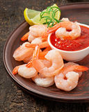 Tails of shrimps with fresh lemon and rosemary. In a ceramic plate Royalty Free Stock Image