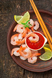 Tails of shrimps with fresh lemon and rosemary. In a ceramic plate Royalty Free Stock Photos