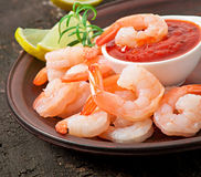 Tails of shrimps with fresh lemon and rosemary. In a ceramic plate Stock Images