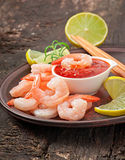 Tails of shrimps. With fresh lemon and rosemary in a ceramic plate Royalty Free Stock Image