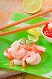Tails of shrimps. With fresh lemon and rosemary in a green plate Royalty Free Stock Images