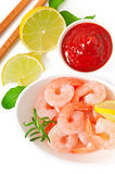 Tails of shrimps with fresh lemon and rosemary. In a white bowl Royalty Free Stock Photography
