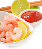 Tails of shrimps with fresh lemon and rosemary. In a white bowl Royalty Free Stock Images