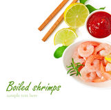 Tails of shrimps with fresh lemon and rosemary. In a white bowl Stock Images