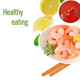 Tails of shrimps with fresh lemon and rosemary. In a white bowl Stock Photo