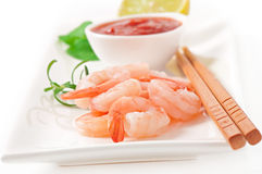 Tails of shrimps. With fresh lemon and rosemary in a white bowl Royalty Free Stock Photo