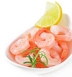 Tails of shrimps. With fresh lemon and rosemary in a white bowl Royalty Free Stock Photos