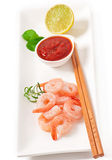 Tails of shrimps. With fresh lemon and rosemary in a white bowl Stock Images