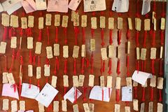 TAINAN, TAIWAN - APRIL 14, 2015. Chihkan Tower at Tainan, Taiwan on April 14, 2015. Students write their wishes on wood plates and leave them inside the shrine Royalty Free Stock Photo