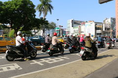 TAINAN, TAIWAN - APRIL 13, 2015. Traffic at Tainan, Taiwan on April 13, 2015. Motor scooters are popular vehicles for people in this city Royalty Free Stock Photos