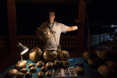 Taino Artisan Selling Wares on Culebra, Puerto Rico. VIEQUES, PUERTO RICO - MARCH 23: An artisan sells his wares to tourists on March 23, 2016. Many small royalty free stock images