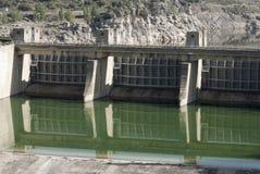 Taintor door dam detaill. Esla river dam Zamora Spain. Concrete, stone and iron Stock Image