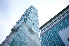 Taipei 101. Low angle view of Taipei 101 Financial Center skyscraper with blue sky and cloudscape background, Taiwan Royalty Free Stock Photography
