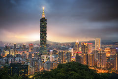 Taipei 101 building and Taipei city at evening. The amazing scene of Taipei 101 building and Taipei city during sunset. The photo has been taken from the top of Stock Image