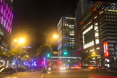 Taipei city street at night with many neon lights Stock Photo