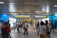 Subway passengers walk through the enormous underground network of the Taipei Metro system. royalty free stock photography