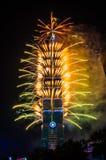 Taipei 101 New Year fireworks. TAIPEI, TAIWAN - JANUARY 2014 - The new year countdown fireworks set ablaze on 1st January 2014 in Taipei 101. A huge crowd Stock Photography