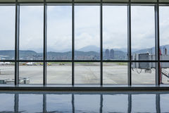 Taipei Songshan   Airport Terminal interior sight  with outside. Viiew Royalty Free Stock Photos