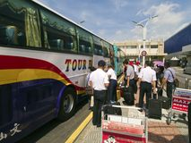 Taipei Songshan Airport : Tourist take the Bus. Taipei, Taiwan - JUNE 27, 2015: Tourist arrival Taipei and take the Bus in Taipei Songshan Airport on June 27 Stock Photos