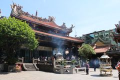 TAIPEI, TAIWAN - APRIL 15, 2015. LongShan Temple at Taiwan on April 15, 2015. LongShan is a famous sacred temple at Taipei, Taiwan for local people and tourist Stock Photos