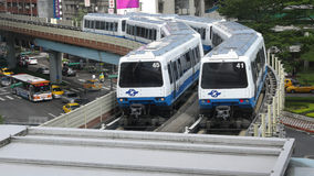 The Train of Taipei Metro Run on The Elevated Corridor, While Other Cars Running on The Road Beneath The Corridor. Stock Photography