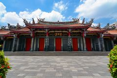 Entrance to Xingtian Gong, a traditional Chinese temple devoted to Guan Yu, the patron god of bu. Taipei, Taiwan - August 5, 2017 - Courtyard in front of Royalty Free Stock Photo