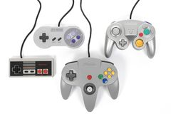 Nintendo`s First Four Gaming Controllers. Taipei, Taiwan - February 19, 2018: A photo of the original four Nintendo game controllers released in North America Stock Images