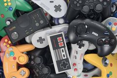 Stack of Retro Video Game Controllers Royalty Free Stock Photo