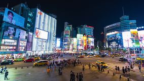 Time lapse of traffic and people walking on crosswalk in the night at Ximending in Taipei, Taiwan. stock footage