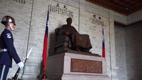 TAIPEI, TAIWAN - MAY 15, 2019: Guard Stading by Chiang Kai Shek Statue in Chiang Kai Shek Memorial Hall