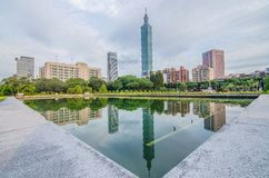 Sunset view of Taipei City by riverside with skyscrapers and beautiful reflections on smooth water Landmarks of Taipei 101 Tower stock image